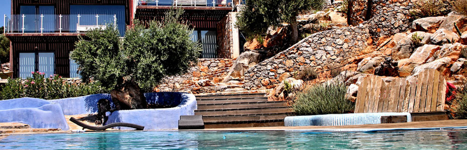 Villa exterior with stonework & swimming pool
